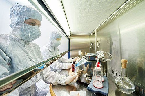 Image showing two pharmaceutical manufacturing professionals working with chemicals