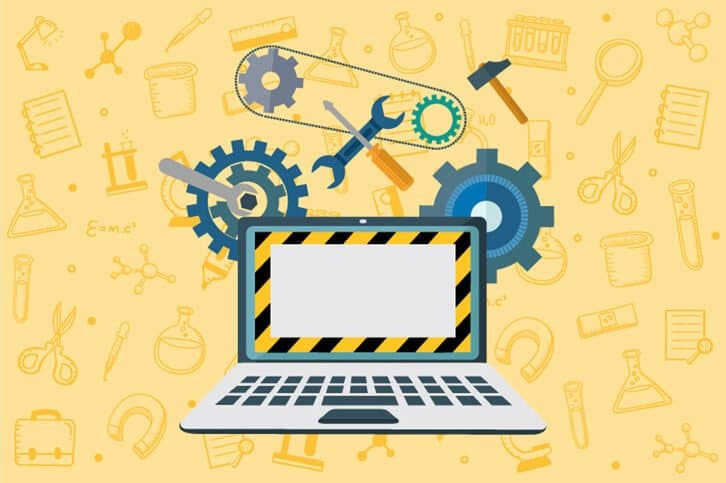 An image to suggest the role of an automation engineer using a laptop computer with gears and pulleys behind it.