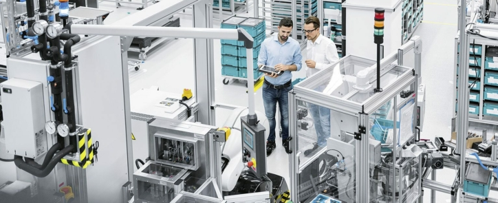 Two automation engineers discussing a project