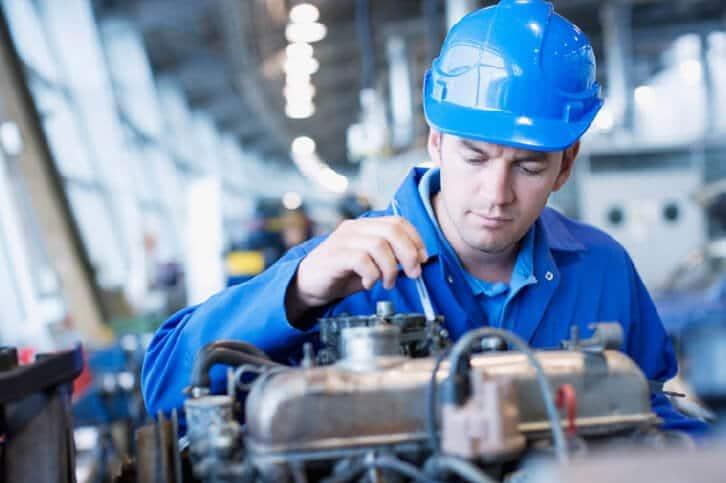 A maintenance technician is repairing an engine