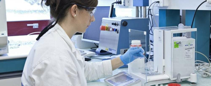 Quality control analyst working in a laboratory