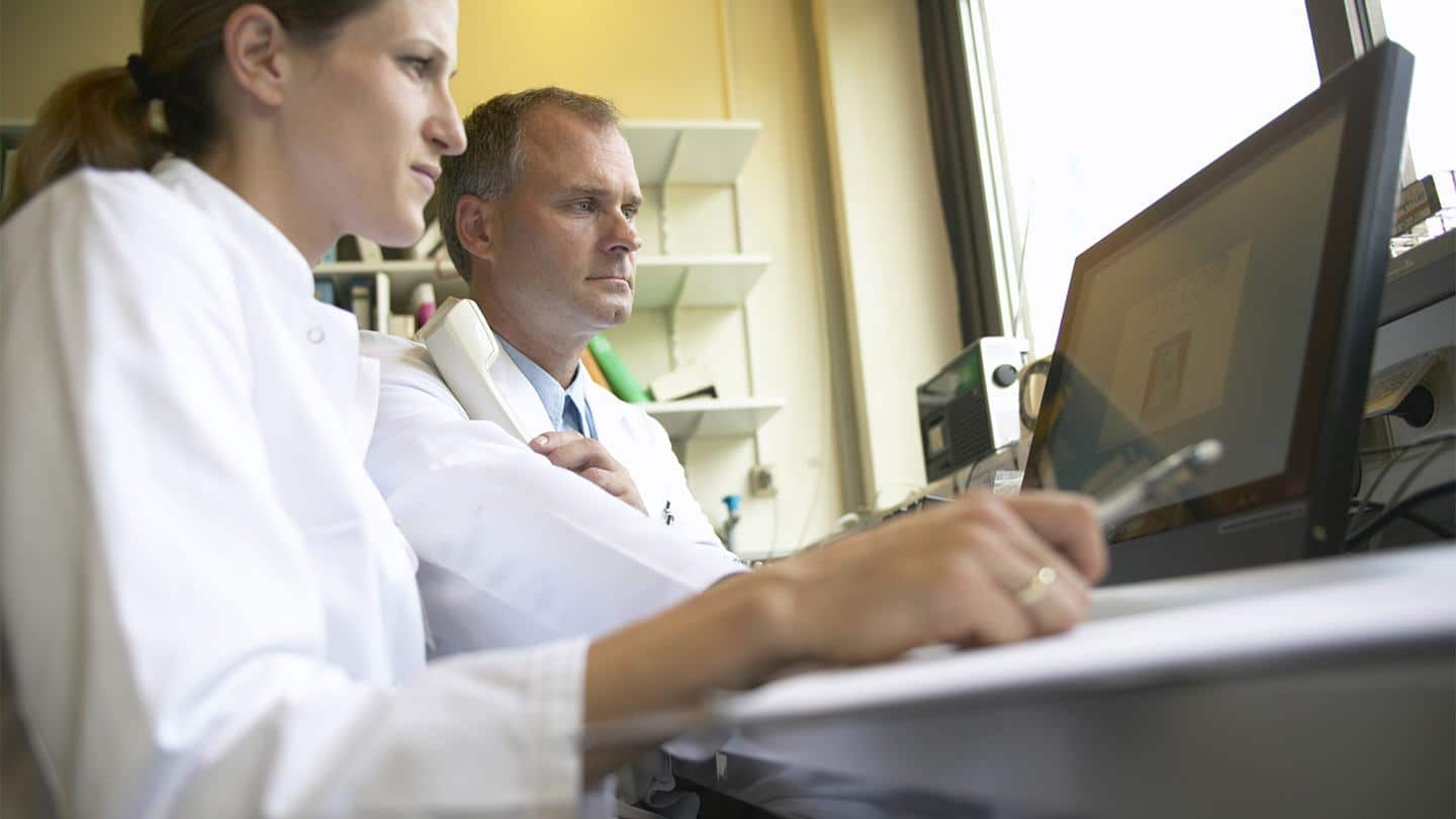 man-and-woman-in-lab-coats-looking-at-a-computer-suggests-considering-how-long-a-career-change-to-pharmaceutical-manufacturing-will-take