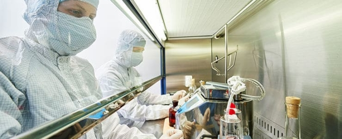 image-showing-two-staff-using-materials-and-equipment-relevant-to-their-pharmaceutical-career