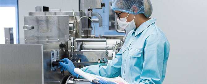manufacturing-engineer-in-personal-protective-equipment-with-clipboard
