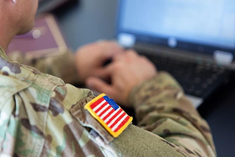 man-in-military-uniform-using-laptop-as-if-hunting-for-answers-to-frequently-asked-questions