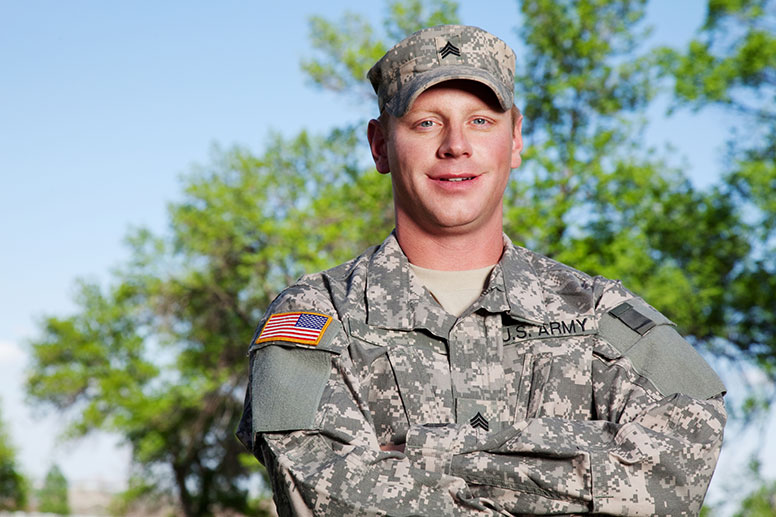 confident-looking-military-man-smiling-with-arms-folded-implying-he-has-figured-out-which-pharma-job-he-could-do