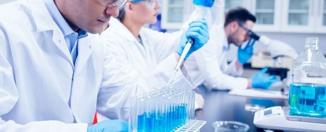 three-biochemists-conducting-experiments-in-pharmaceutical-laboratory