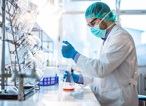 Male biotechnologist testing new chemical substances in a lab